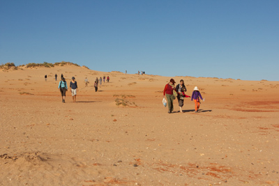 trail walkers on dune